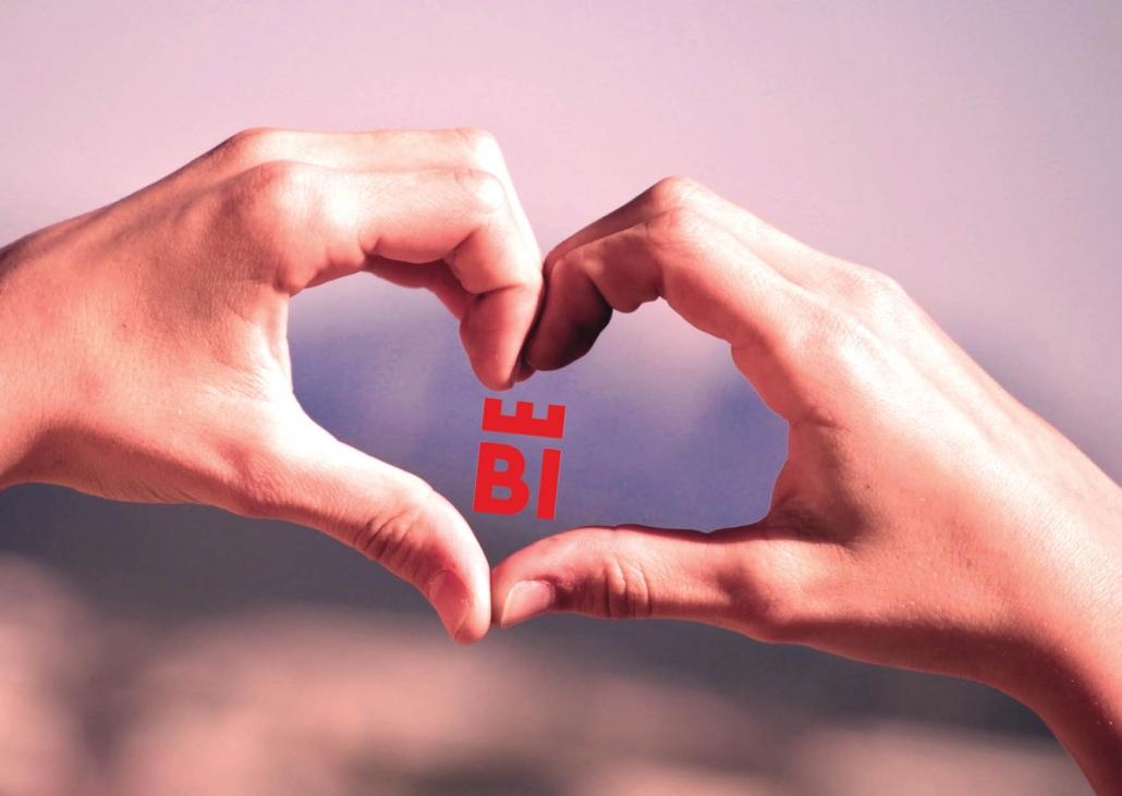 zwei Händen die ein Herz formen, in der Mitte ist das neue Logo von Bielefeld